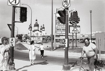 <b>John Paskievich</b>. <i>Main Street and Redwood Avenue</i>, from the series The North End Winnipeg. 1985. Collection of the Winnipeg Art Gallery, courtesy of University of Manitoba Press.
