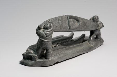 <b>Jimmy Inaruli Arnamissak</b>. <i>Two Men Loading Kayak onto Qamutiik (sled)</i>, c. 1980. Stone, 19.5 x 51 x 13.5 cm. Collection of the Winnipeg Art Gallery. Gift from the Collection of George and Tannis Richardson, 2011-61. Photograph: Ernest Mayer, courtesy of the Winnipeg Art Gallery.