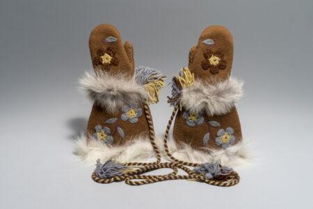 Mona Rebecca Ittiraqtaataq.Canadian (Taloyoak), b. 1941. Mittens, 1976.wool, wool duffle, wool yarn, embroidery thread, fur;(a) : 40 x 26.5 x 6 cm; (b) : 40 x 26.5 x 6 cm.Government of Nunavut Fine Art Collection. On long-term loan to the Winnipeg Art Gallery, 2.76.22 ab.Photo: Lianed Marcoleta.