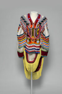 Unidentified artist.Amautik, c. 1995.wool duffle, glass beads, nylon fringe, cotton ribbon, cotton thread, and felt,150 x 90 cm.Collection of the Winnipeg Art Gallery;Gift of Helen Webster in honour of Thomas Webster and his contribution to representing Inuit artists and the promotion of Inuit Art and Culture, 2018-160.