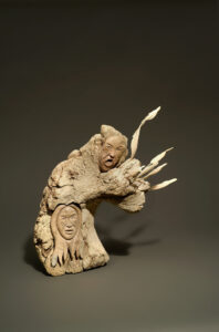 Manasie Akpaliapik (Canadian (Arctic Bay), b. 1955).Shaman Summoning Taleelayuk to Release Animals, 1989.whale bone, narwhal ivory,43.7 x 40.2 x 27.8 cm.Collection of the Winnipeg Art Gallery. Acquired with funds from The Winnipeg Art Gallery Foundation Inc., G-90-506.Photo: Ernest Mayer.