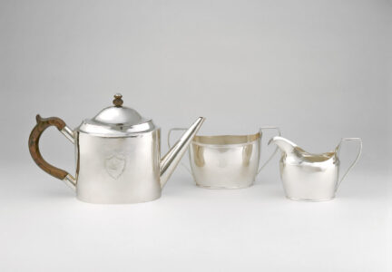 Pierre Huguet dit Latour, Sr. (workshop of) (Canadian, 18th century). Tea service, c. 1790–1800.silver, wood.(a) teapot: 17.8 x 11.1 x 30 cm; (b) sugar bowl: 10.5 x 20.1 x 9.4 cm; (c) cream jug: 10.3 x 7.8 x 15.7 cm.Collection of the Winnipeg Art Gallery; Acquired with a repatriation grant from the Government of Canada through the Cultural Property Export and Import Act and donations from friends in memory of Mrs. Bernard Naylor, G-83-241 abc.Photo: Ernest Mayer