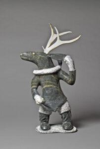 Iola Abraham Ikkidluak (Canadian (Kimmirut), 1936–2003). Caribou Shaman, 1992, stone, antler, 61 x 31.5 x 16 cm. Collection of the Winnipeg Art Gallery. Gift of Dr. Harry Winrob, 2006-534.1 to 3. Photograph: Ernest Mayer, courtesy of the Winnipeg Art Gallery.