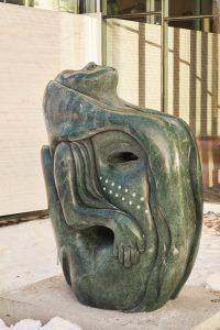 Goota Ashoona (b. 1967, Kinngait). Tuniigusiia/The Gift, 2020. Verde Guatemala marble.Collection of the Winnipeg Art Gallery. Commissioned by The Manitoba Teachers'Society on behalf of Manitoba's public school teachers. Photo: Courtesy of the WAG.
